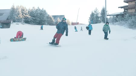 snowbord : 14-12-19 RUSSIA, KAZAN: A family snowboarding on the mountain