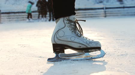 ice skating : A woman skating on ice rink - slowing down Stock Footage