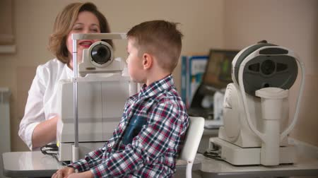 yarık : A treatment in eye clinic - checking little boys eye vision indoors