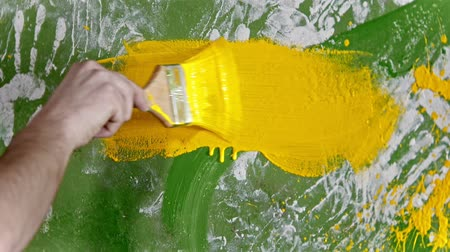 splattered : Painting wall with yellow color paint Stock Footage