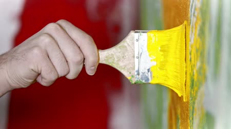 splattered : Painting wall with yellow color paint - special interior design for the new apartment