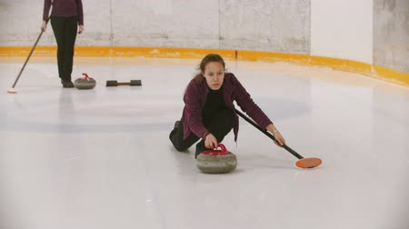 gránit : Curling training in the sport complex - woman skating on the ice Stock mozgókép