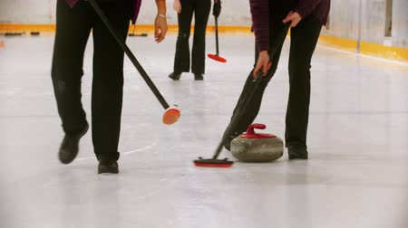 gránit : Curling - leading granite stone on the ice - clearing the ice before the stone
