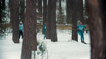narciarz : RUSSIA, KAZAN 08-02-2020: Skiing competition - adult sportsmen skiing in the woods with an effort