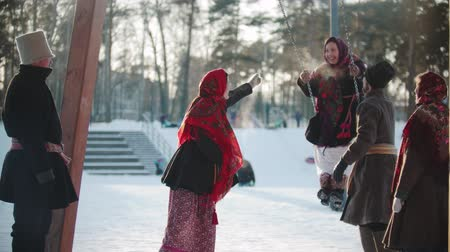 festividades : Russian folklore - Russian girl swinging and everyone is laughing on a sunny day