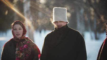 symbol : Russian folklore - Russian women and men are smiling at the camera on sunny day