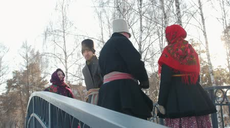 festividades : Russian folk - men in traditional costumes dance on the bridge Vídeos