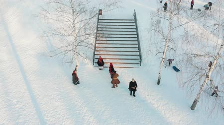 symbol : Russian folklore - russian people in traditional costumes are dancing on the stairs