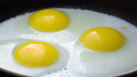 tweak : Cooking Fried eggs. Process of Preparation of Three Fried Egg. Time Lapse.