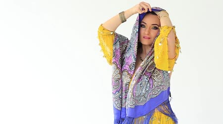 Beautiful girl in arabian national clothes in studio on white backgraund Stock Footage