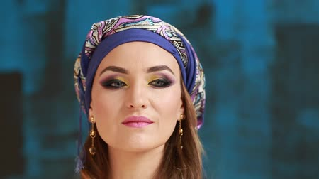 Beautiful girl in arabian national clothes on blue backgraund