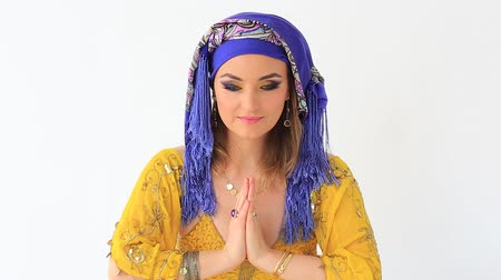 Beautiful girl in arabian national clothes in studio on white and blue backgraund