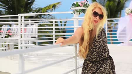 beautiful girl in a leopard dress on the caribbean roof. Stock Footage