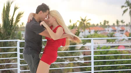 Young beautiful happy couple on the roof in the caribbean resort