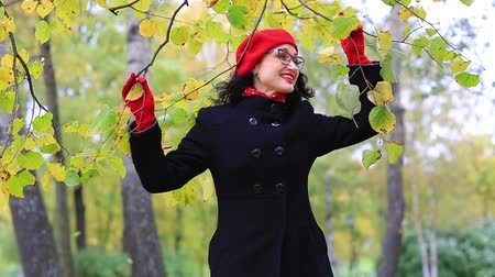 Woman dancing in autumn park
