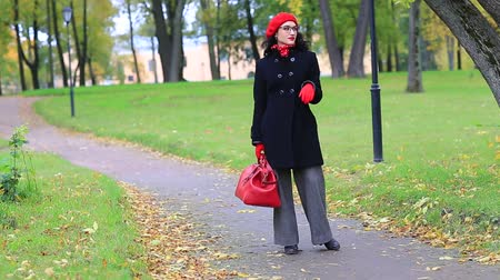 woman going with red bag Stock Footage