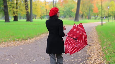 forget : woman with red umbrella in the autumn park.