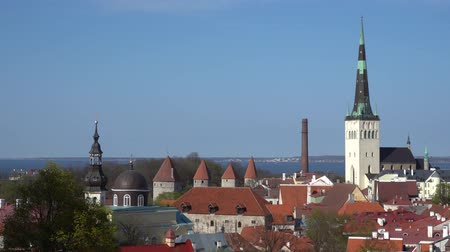 balti tenger : Amazing aerial Tallinn view over the old town, cathedral and narrow streets surrounded by orange roofs.
