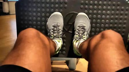 consistency : Leg workout in gym in slowmotion Stock Footage