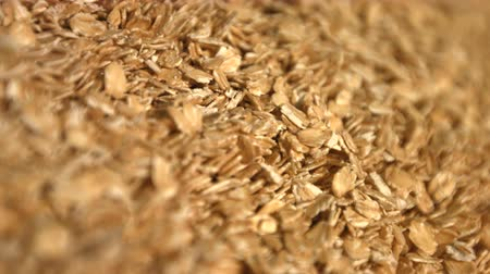 yulaf ezmesi : Oatmeal on a green background. Slow motion. Close-up. Vertical pan. 2 Shots Stok Video