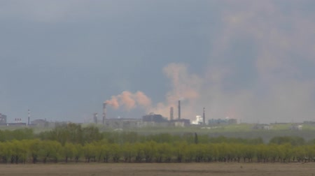 demirli : Electrometallurgical plant in a cloud of brown smoke. Pipes of an electrometallurgical plant.