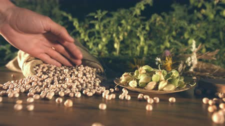 gram : Still life with chickpeas. Slow motion. The glide of the camera (from right to left) along the table with a chickpeas. Stock Footage