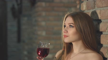 crypt : A beautiful girl is drinking wine. 2 Shots. Slow motion.