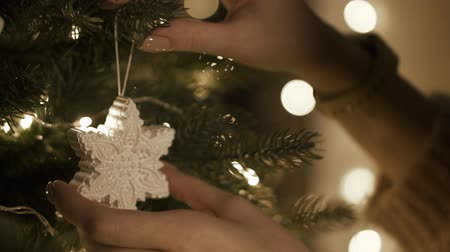 Christmas Decoration on tree. Pan up down. Background warm bokeh