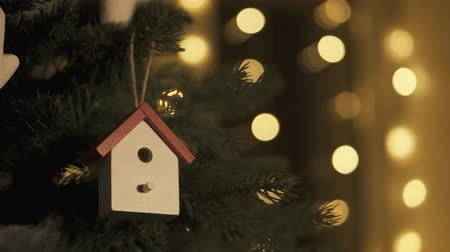christmas background : Christmas tree decoration with toys. Hanging nesting box on tree Stock Footage
