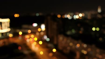 compositing : Blurred bokeh light spots on black background. Lights of the night city and street.