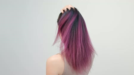 цветной : Portrait of a young woman on a white background. Long dyed hair. Ombre, color staining. Lilac and blue. Concept work hair stylist. Стоковые видеозаписи