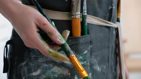 şövale : Brushes in the hands of the artists women. Drawing and art. Creative profession and inspiration. Stok Video