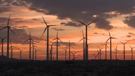 электричество : sunset wind turbines