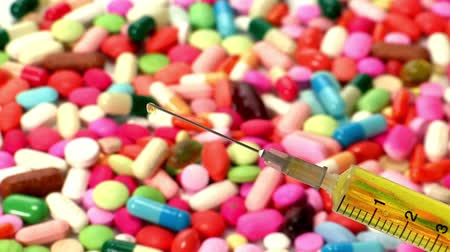 nutritional supplement : syringe against the background of pills