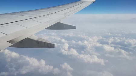 view above the clouds from an airplane Стоковые видеозаписи