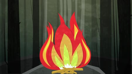 kamp ateşi : Dynamic graphic animation using paper cutout styled elements to illustrate a camp fire in the woods. High definition 1080p and loop-ready. Paper Cutout – This is one of a suite of simple paper cutout style animated illustrations which have similar  Stok Video