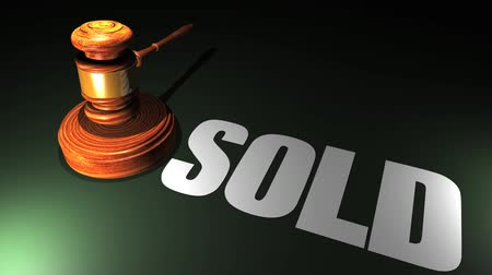 palička : High definition animation of an auction gavel hitting a block with the word SOLD appearing on the desk.