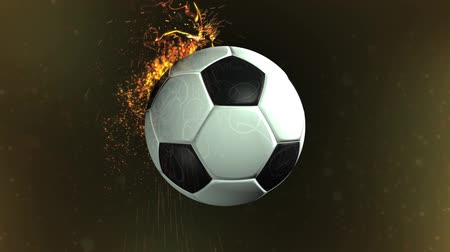 piłka nożna : High definition animated background loop of a revolving soccer ball with added particle effects. Wideo