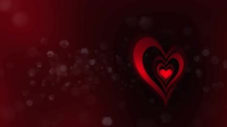 red symbol : High definition animated loop of three dimensional heart graphics over a dark red abstract  background.