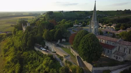 Aerial view of church of sainte croix du mont at sunset, sainte croix du mont, france Stock mozgókép