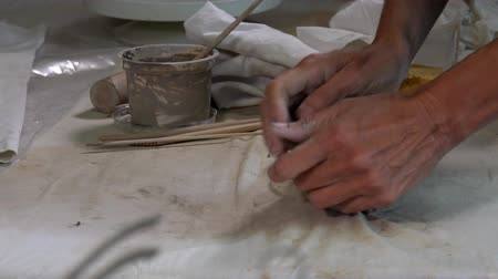 Artist working in a ceramic workshop, france Stock mozgókép