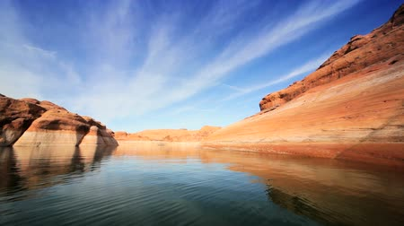climate : Traveling across the waters of Lake Powell between sandstone cliffs showing the drop in water levels through climate change Stock Footage
