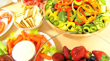 zöldségek : Table laid with delicious fresh fruit, vegetables, meat & chesse as part of a healthy lifestyle diet