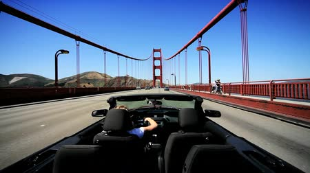 gates : Luxury convertible car being driven across San Fanciscos Golden Gate Bridge Stock Footage