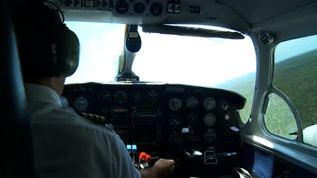 pilótafülke : Pilot in the cockpit, at the controls of his light aircraft  Stock mozgókép