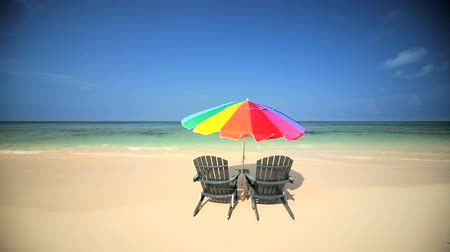 стулья : Sun parasol & easy chairs  on the beach on a paradise island