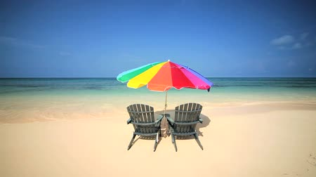 rejtekhely : Sun parasol & easy chairs inviting you to relax on a peaceful sandy beach Stock mozgókép
