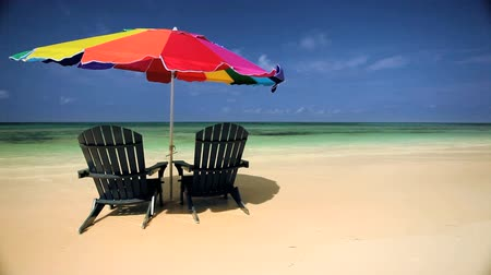 стулья : Sun parasol & easy chairs  on a paradise island sandy beach Стоковые видеозаписи