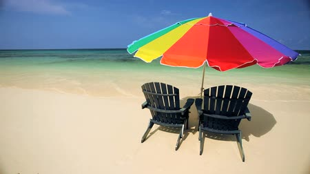 остров : Sun parasol & easy chairs  on the beach on a paradise island