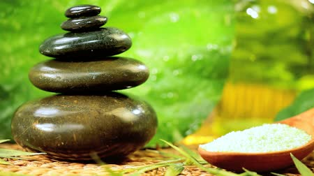 sůl : Spa products of salts, balanced stones & green leaves tp enhance cleansing & wellbeing